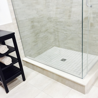 New modern bathroom with shower and ceramic floor.