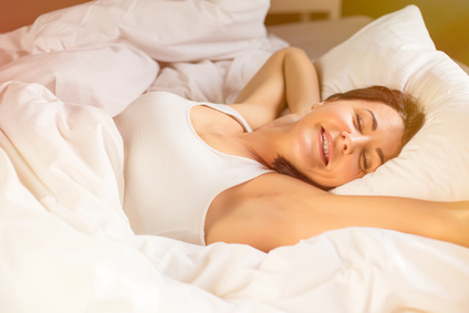 Relaxed woman sleeping in bed