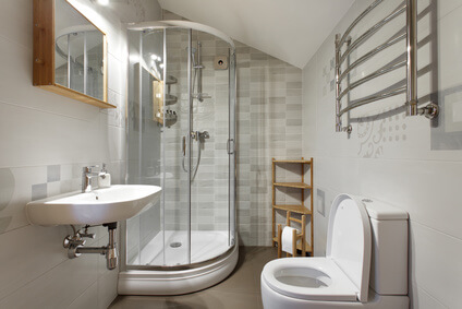 Small bathroom with toilet and shower in gray tones
