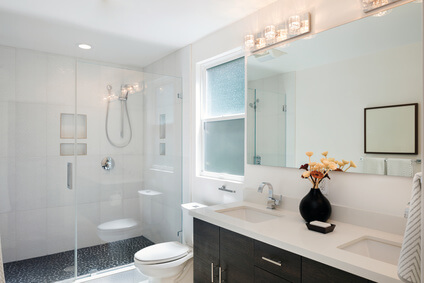 Modern bathroom interior with glass door shower and white cabine